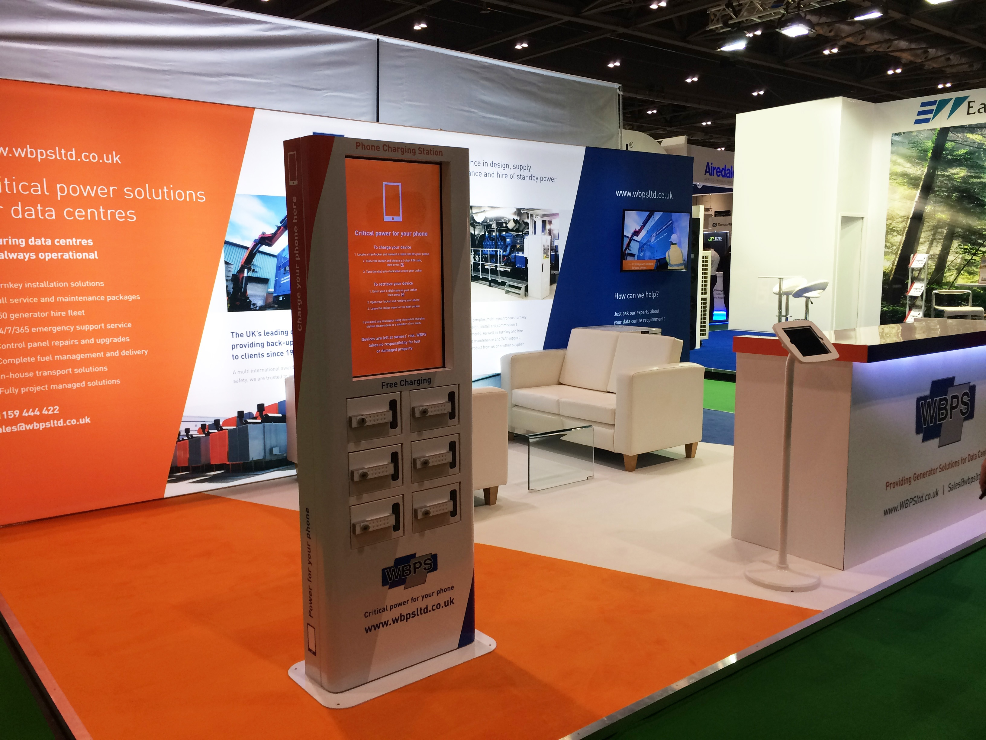 WBPS stand featuring mobile phone charging point on exhibition stand
